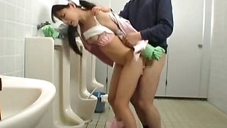 Asian bathroom attendant is in the mens