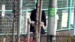 Asian students urinating outdoors