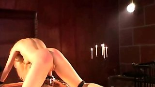 Slave crying and begging for mercy in a heating bdsm game