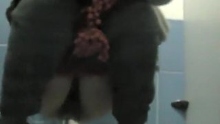 Woman with hairy pussy pissing