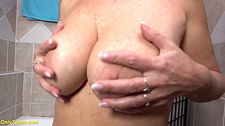 big natural breast mom peeing in the bathtub