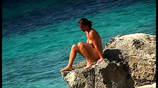 Nudist beach voyeur finds two sexy girls enjoying the sun