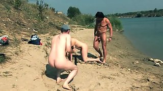 Naked mature on beach with 2 horny cocks