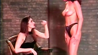 Naughty spanking session in the dungeon with two kinky slags