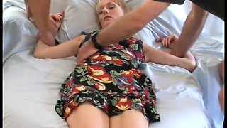 Blonde mom gets her mouth and cunt fucked by two masked dudes