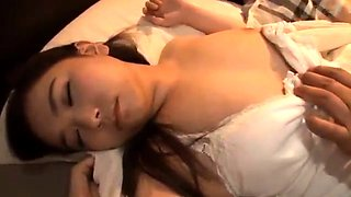 Sleeping Japanese housewife gets treated to a deep pounding