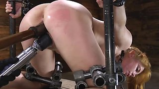 Chubby redhead has her holes stuffed with master's sex machines