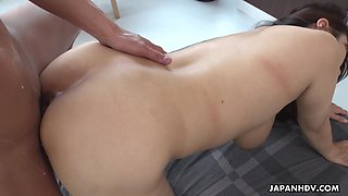 Ample breasted Japanese girl is squirting milk while sucking a dick